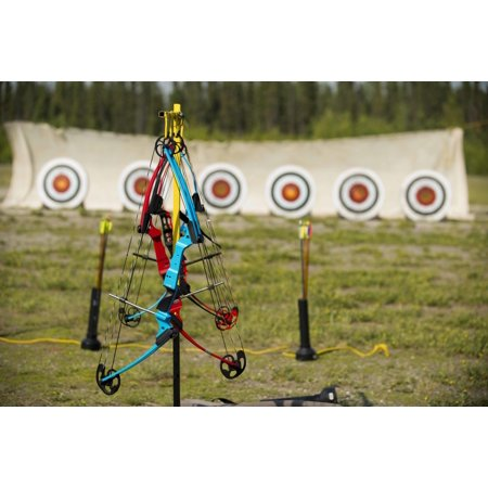 LAMINATED POSTER Compound bows hang ready to be used during an archery class at the Skeet, Trap and Archery Range on Poster Print 24 x 36