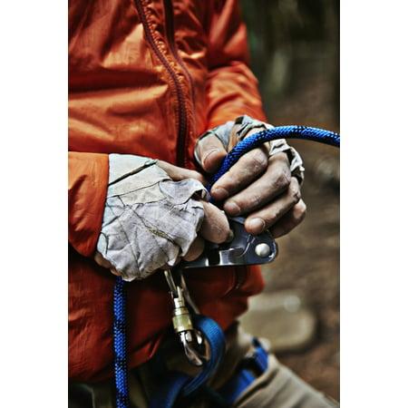 Man adjusting rock climbing equipment in the Adirondacks New York USA PosterPrint