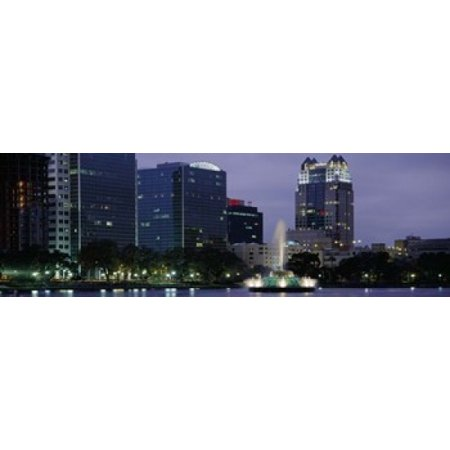 Fountain in a lake lit up at night Lake Eola Summerlin Park Orlando Orange County Florida USA Canvas Art - Panoramic Images (36 x 12) ()