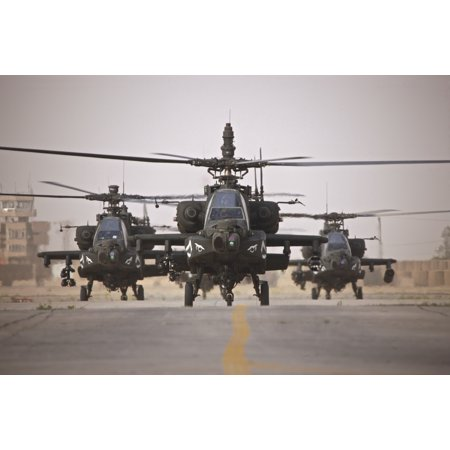A group of four AH-64D Apache Longbow helicopters return to COB Speicher in Tikrit Iraq after completing a mission over Northern Iraq during Operation Iraqi Freedom Poster Print (Groups Of Four)
