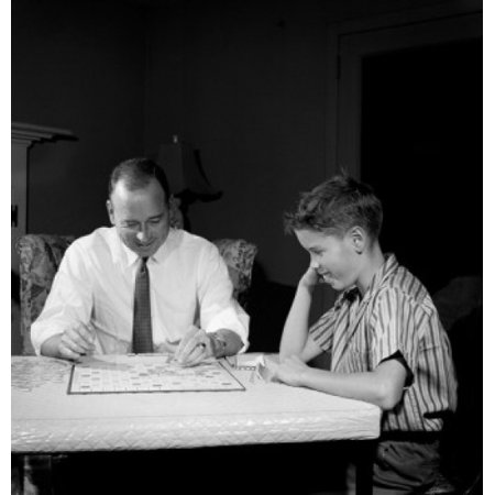Father Playing Scrabble With Son In Home Poster Print