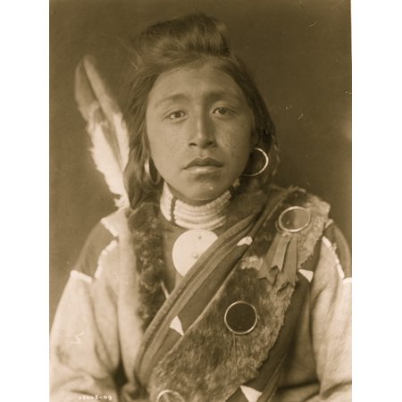 Kashhila--Wisham Male Chinookan Indian head-and-shoulders portrait facing front with pompadour fur wrapped braids bead choker around neck beaded buckskin shirt fur sash over left shoulder Poster Print