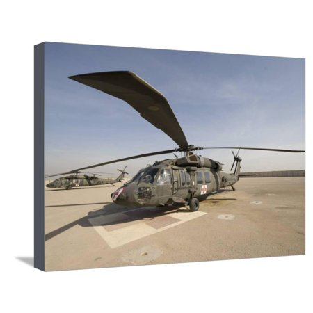 UH-60 Blackhawk Medivac Helicopter Sits on the Flight Deck at Camp Warhorse Stretched Canvas Print Wall Art By Stocktrek Images