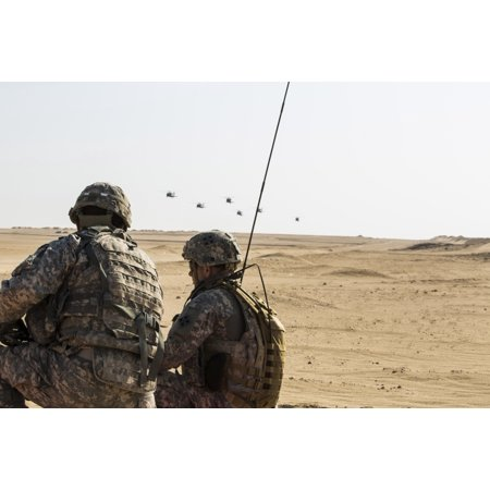UH-60 Black Hawk helicopters prepare to airdrop soldiers in Kuwait Canvas Art - Stocktrek Images (34 x 23)