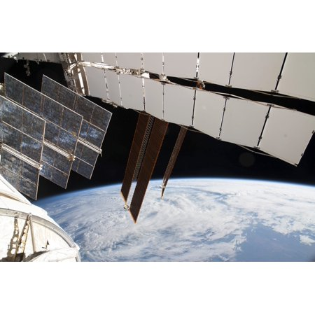 February 5 2014 - Solar array panels on the Russian segment of the International Space Station and a blue and white part of Earth Poster Print
