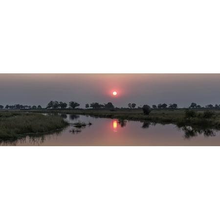 Reflection of sun in river at dusk Kings Pool Camp Linyanti Okavango Delta Botswana Canvas Art - Panoramic Images (36 x 12) - 5 Rivers Delta Halloween