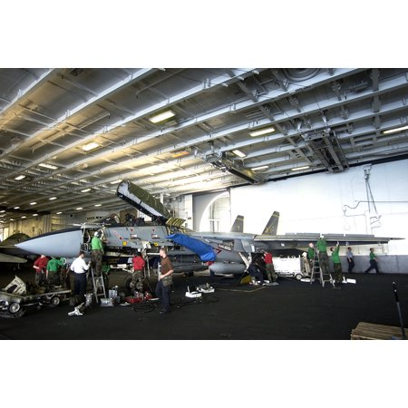 Thirty Two Wrap (LAMINATED POSTER Sailors assigned to the Swordsman of Fighter Squadron Thirty Two (VF-32) perform maintenance to an F Poster Print 24 x 36)