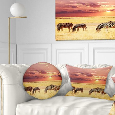DESIGN ART Designart 'Zebras Grazing Together at Sunset' Modern Landscape Printed Throw Pillow