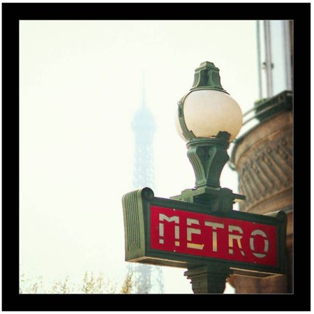 Metro Sign In Paris With Eiffel Tower In The  Background. by Eazl Black Canvas Image -