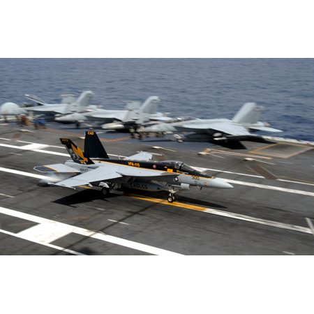 LAMINATED POSTER A U.S. Navy Boeing F/A-18E Super Hornet of Strike Fighter Squadron (VFA) 115 Eagles makes an arres Poster Print 24 x 36