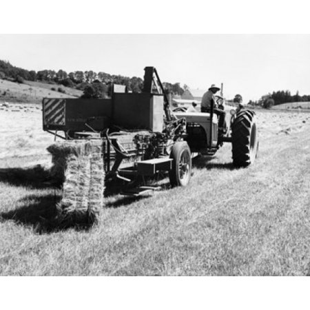 Farmer sitting on a tractor pulling hay baler in a field Canvas Art - (18 x 24)