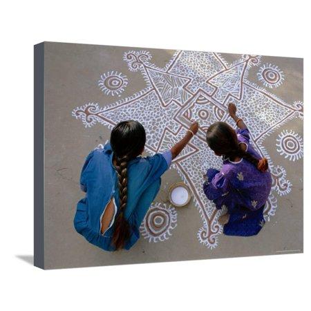 Women Painting a Mandana on the Ground, Village Near Jodhpur, Rajasthan, India Stretched Canvas Print Wall Art By Bruno Morandi