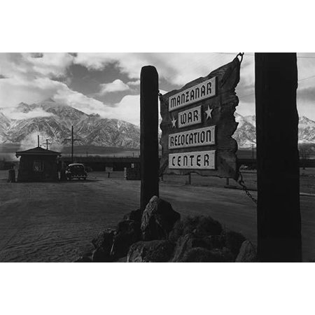 Wooden sign at entrance to the Manzanar War Relocation Center with a car at the gatehouse in the background  Ansel Easton Adams was an American photographer best known for his black-and-white