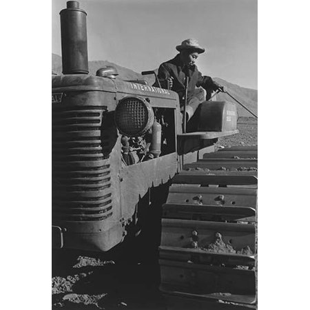 Close-up of tractor with driver pulling a rope  Ansel Easton Adams was an American photographer best known for his black-and-white photographs of the American West  During part of his career he was