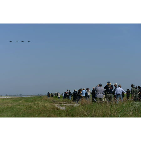 LAMINATED POSTER International media members take photos of a formation of U.S. Air Force F-15E Strike Eagles from th Poster Print 24 x 36 ()
