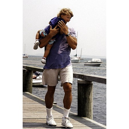 Arnold Schwarzenegger and his daughter on a wharf Photo