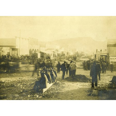 Main Street Goldfield Nevada Ca 1900 A Very Busy Street Scene Of This Famous Town Goldfield Nevada People In The Town There Is Some Signage Etc Many People Moving About Un-Loading Wagons Un-Loading Su ()