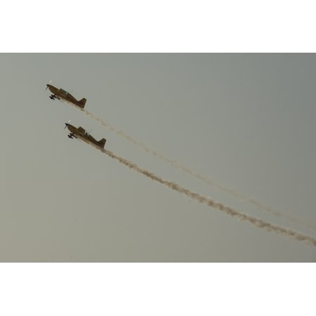 LAMINATED POSTER A DHL Extra 200 and Extra 300 aerobatic aircraft perform during the 2014 Bahrain International Airsh Poster Print 24 x (16 Extra Length Aircraft)