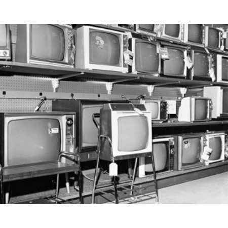 Televisions in an electronics store Poster Print (18 x 24) Televisions in an electronics store was reproduced on Premium Heavy Stock Paper which captures all of the vivid colors and details of the original. The overall paper size is 18.00 x 24.00 inches and the image size is 18.00 x 24.00 inches. This print is ready for hanging or framing.  Brand New and Rolled and ready for display or framing.  Print Title: Televisions in an electronics store. Paper Size: 18.00 x 24.00 inches. Product Type: Poster Print.