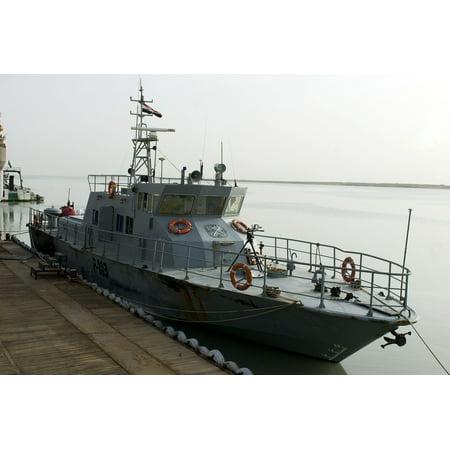 LAMINATED POSTER An Iraqi Navy coastal patrol boat is moored to a pier at Umm Qasr, south port terminal in Basra, Ir Poster Print 24 x 36 - Halloween At Navy Pier