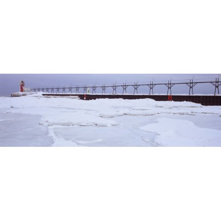 Frozen lake with a lighthouse in the background Lake Michigan St Joseph Michigan USA Canvas Art - Panoramic Images (36 x 12)