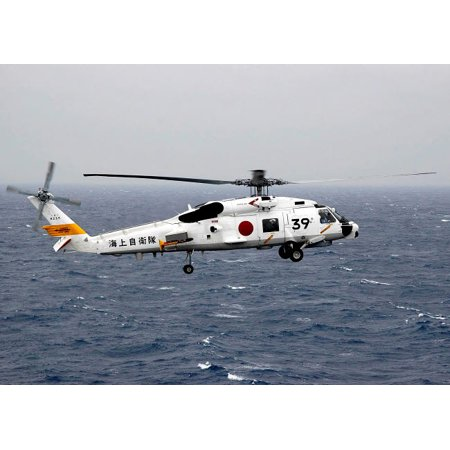 A Japan Maritime Self Defense Force H-60 helicopter in flight Poster Print by Stocktrek