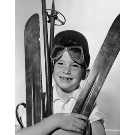 Boy holding skiing equipment Canvas Art - (18 x 24)