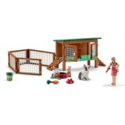 Rabbit Hutch with Rabbits and Feed