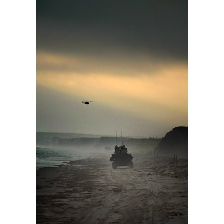 Light Armored Reconnaissance - LAMINATED POSTER A 1st Light Armored Reconnaissance Battalion light-armored vehicle returns to its beachhead landing Poster Print 24 x 36