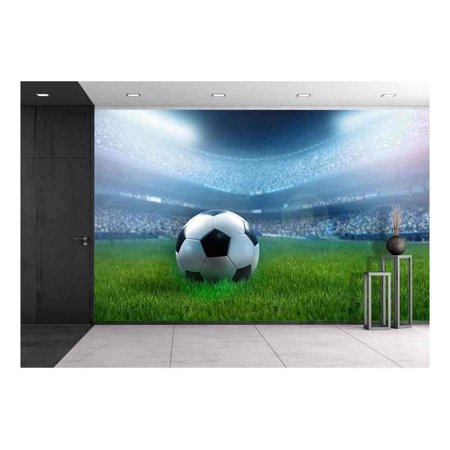 wall26 - Close Up of a Football Ball on a Full Stadium - Removable Wall Mural | Self-Adhesive Large Wallpaper - 100x144
