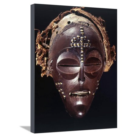 Chokwe dance mask of a type known as Mwana Pwo, Angola or DR Congo, 19th or 20th century Stretched Canvas Print Wall Art By Werner Forman