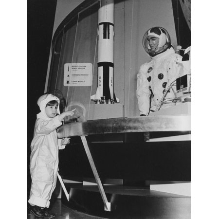 A Young Boy Wearing an Astronaut Costume Looking at a NASA Display on Space Travel Print Wall Art](Party At Display And Costume)