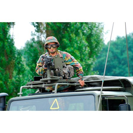 An infantry soldier of the Belgian Army mans a FN MAG machine gun mounted on top of the Unimog vehicle Poster Print by Luc De JaegerStocktrek (Man With The Machine Gun Black Mages)