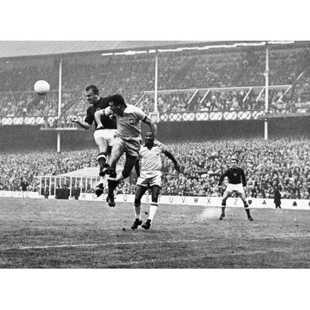 World Cup 1966 Nkalman Meszoly Of Hungary And Hilderaldo Bellini Of Brazil Head The Ball During The 1966 World Cup Held In England Photograph 15 July 1966 Poster Print by Granger
