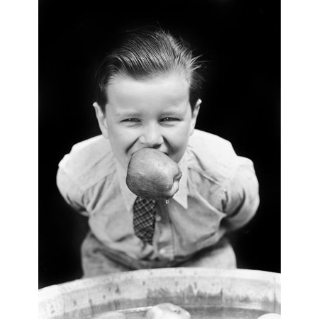 Bobbing For Apples Halloween (1930s Boy Bobbing For Apples With An Apple In His Mouth Looking At Camera Poster Print By Vintage)
