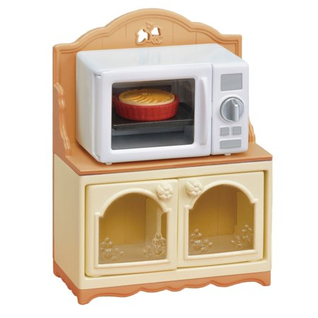 Calico Critters Microwave Cabinet, Furniture Accessories Microwave Cabinet has a microwave oven that comes in handy when cooking. Microwave Cabinet includes a microwave oven and designated cabinet. Turning the dial on the microwave oven turns the inside red. The cabinet acts as a storage space, allowing for storage of other accessories. Have even more fun playing together with the Kitchen Play Set, Dining Room Set, and other kitchen furniture (sold separately). Includes: Microwave Oven, Cabinet, Apple Pie, Tabletop. For ages 3 and up.