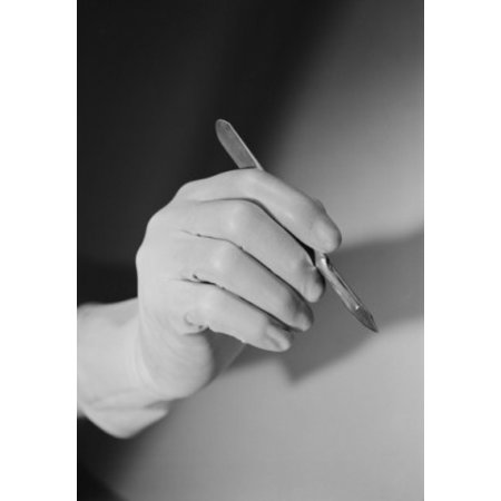 Hand holding scalpel Canvas Art - (24 x 36)