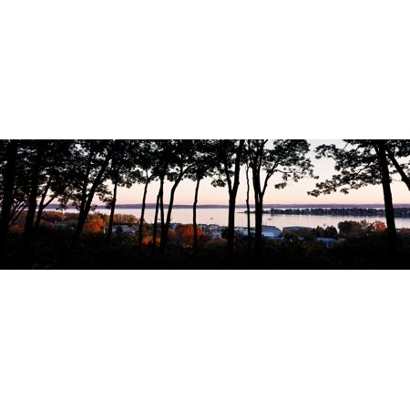 Silhouette of trees at dusk Little Traverse Bay Harbor Springs West Traverse Township Emmet County Michigan USA Canvas Art - Panoramic Images (6 x 18)