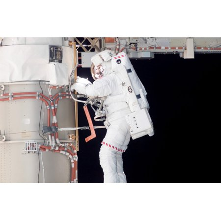 Astronaut Participates In Extravehicular Activity Removing All Of The Launch Locks Holding The 10 Foot Wide Solar Alpha Rotary Joint In Place And Began The Solar Array Retraction Poster Print
