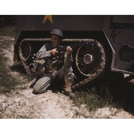 A soldier holds and sights his Garand rifle next to a half-track at Fort Knox Kentucky Poster Print by Stocktrek (Kentucky Rifle Replica)