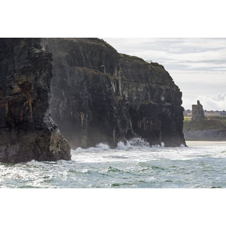 Dark Straight Cliffs With Waves Crashing Into The Rock With Ruined Castle Turret In Background Ballybunion County Kerry Ireland Posterprint