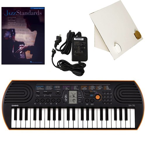 Casio SA-76 44 Key Mini Keyboard Deluxe Bundle Includes Bonus Casio AC Adapter, Desktop Music Stand & Jazz Standards Beginning Piano Solo Songbook