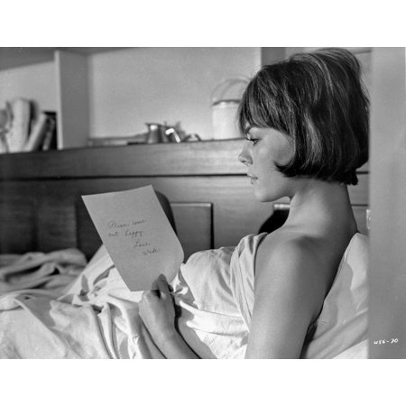 Inside Daisy Clover Woman Reading a Pocket Book on The Bed Photo Print