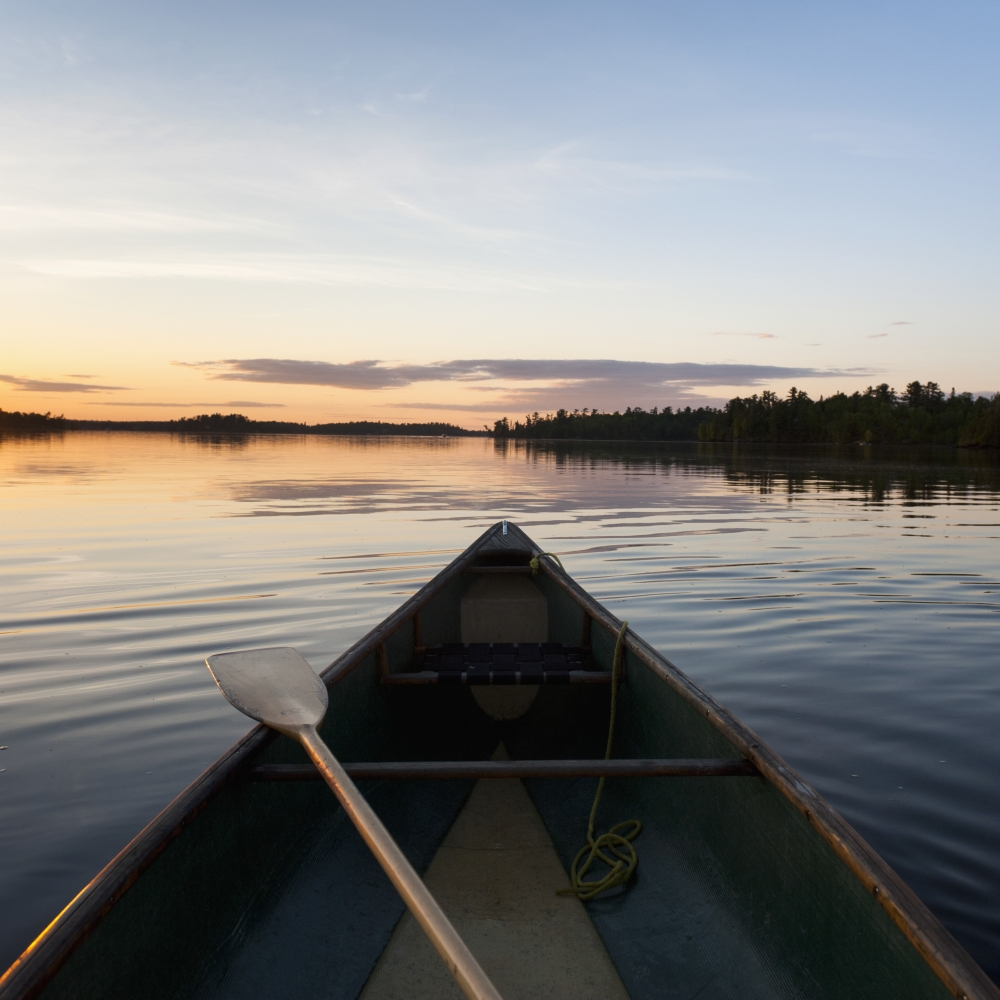 A Boat And Paddle On A Tranquil Lake At Sunset Lake Of The Woods Ontario Canada Canvas Art - Keith Levit Design Pics (15 x 15)
