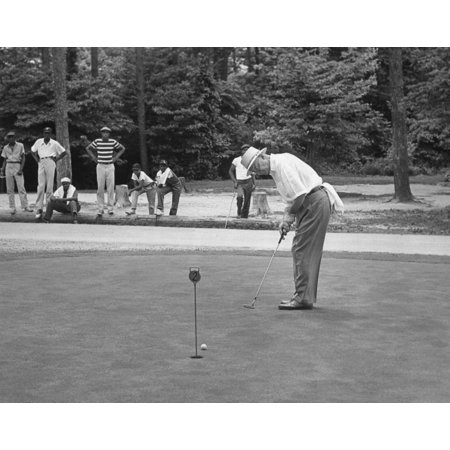 President Dwight Eisenhower On A Putting Green Of A Golf Course August 1957 African American Caddies Watch From The Distance - History
