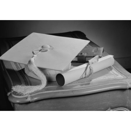 Graduation diploma and mortar board on bedside table Stretched Canvas - (18 x 24)