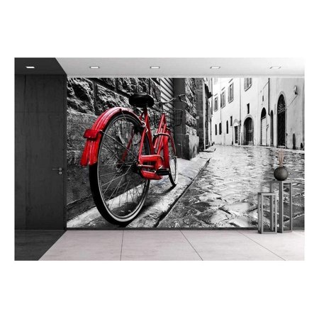 wall26 - Retro Vintage Red Bike on Cobblestone Street in The Old Town. Color in Black and White. Old Charming Bicycle Concept - Removable Wall Mural | Self-Adhesive Large Wallpaper - 66x96