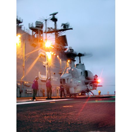 LAMINATED POSTER At sea aboard USS Belleau Wood (LHA 3) Aug 2, 2001-- An AH-1 Cobra attack helicopter is refueled d Poster Print 24 x 36