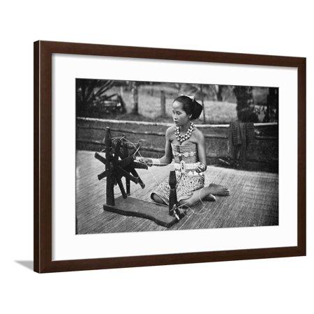 A Dayak girl at her spinning wheel, 1902 Framed Print Wall Art ()