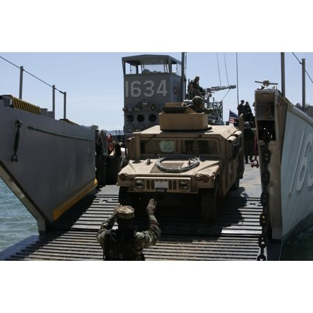 September 26 2008 - US Marines load an M1114 Humvee back on to the US Navy Landing Craft Utility 1634 at Camp Hansen Okinawa Japan Poster Print (Camp Crafts)